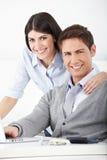 Equipe feliz do negócio no escritório Imagem de Stock Royalty Free