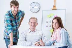Equipe feliz dos arquitetos Imagem de Stock Royalty Free