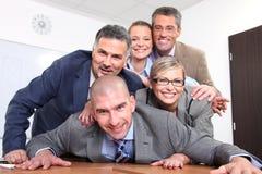 Equipe feliz dos executivos fotografia de stock royalty free