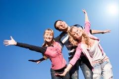Equipe feliz dos jovens do riso Fotografia de Stock