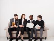 Equipe feliz, executivos do riso Fotografia de Stock Royalty Free