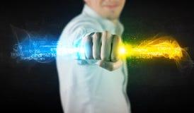 Equipe guardar dados de incandescência coloridos em suas mãos Fotografia de Stock Royalty Free