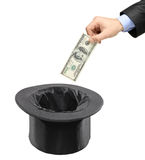 Equipe a introdução de um dólar em um chapéu negro Fotografia de Stock