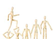 Equipe ir acima nas cabeças de outros povos Imagem de Stock