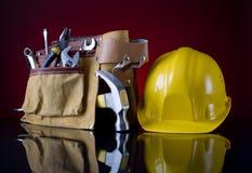Correa y casco de la herramienta Foto de archivo libre de regalías