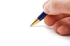 Equipe a mão e a pena com espaço vazio para a escrita Fotografia de Stock Royalty Free
