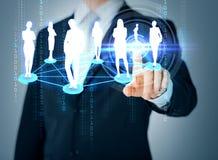 Equipe a mão que aponta no social ou na rede do negócio imagens de stock royalty free