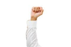 Equipe o braço com camisa branca e o punho apertado isolados no fundo branco Fotos de Stock