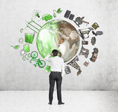 Equipe o pensamento sobre o ambiente, a produção de petróleo e o ico ecoenergy Imagem de Stock