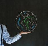 Homem com o mundo na palma de sua mão Imagem de Stock