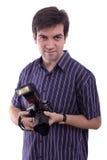 Equipe o sorriso com uma câmera nova da foto do dSLR Imagens de Stock Royalty Free