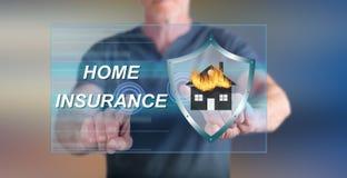 Equipe o toque de um conceito home do seguro em um tela táctil Foto de Stock Royalty Free