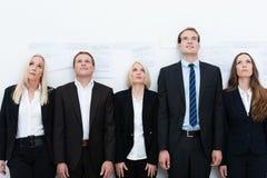 Equipe profissional que olha acima Foto de Stock