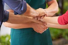 Equipe que empilha as mãos para a motivação Imagem de Stock Royalty Free