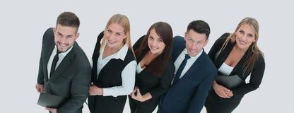 Equipe segura e profissional do negócio que sorri e que olha acima fotografia de stock