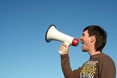 Equipe Shouting através do megafone Foto de Stock