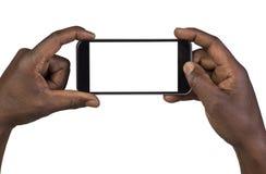 Equipe a tomada de uma imagem usando um telefone esperto Fotografia de Stock