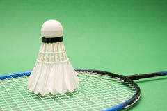 Equipment. For badminton on the green background Stock Image