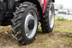 Equipment for agriculture, machines  presented to an agricultural exhibition.  Tractors outdoors Royalty Free Stock Photography