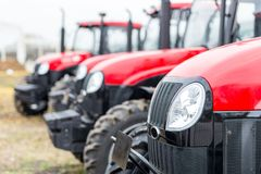 Equipment for agriculture, machines  presented to an agricultural exhibition.  Tractors outdoors Stock Photos