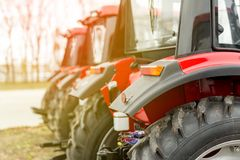 Equipment for agriculture, machines  presented to an agricultural exhibition.  Tractors outdoors Royalty Free Stock Images