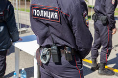 Equipment on the belt of Russian policeman. Text in russian:. SAMARA, RUSSIA - APRIL 24, 2016: Equipment on the belt of Russian policeman. Text in russian stock photo