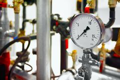 The equipment of the boiler-house, - valves, tubes, pressure gauges.  Royalty Free Stock Photo