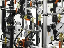 The equipment of the boiler-house, - valves, tubes, pressure gauges Royalty Free Stock Images