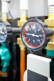 The equipment of the boiler-house, - valves, tubes, pressure gauges, thermometer.  Stock Images
