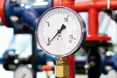 The equipment of the boiler-house, - valves, tubes, pressure gauges, thermometer. Close up of manometer, pipe, flow meter, water p. Umps and valves of heating stock image