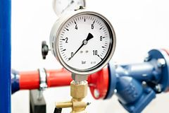 The equipment of the boiler-house, - valves, tubes, pressure gauges, thermometer. Close up of manometer, pipe, flow meter, water p. Umps and valves of heating royalty free stock photography