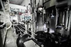 Equipment for bottling on microbrewery royalty free stock photo