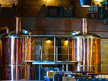 Equipment for brewing at restaurant, bar, pub. Breweries in the restaurant. Creative background. Copper brewing tanks in the brewhous. Equipment for brewing at Stock Photography