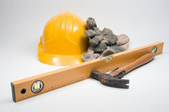 Equipment for Builder. Builder's equipment - protective gloves, industrial helmet, builder's level and hammer Royalty Free Stock Photo