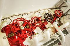 Equipment, cables, pipes and valves in engine room of a ship pow stock image