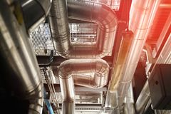 Equipment, cables and piping at factory royalty free stock image