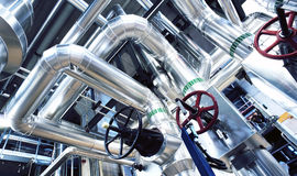 Equipment, cables and piping as found inside of a modern industr Stock Photography