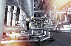 Equipment, cables and piping as found inside of a modern industr Stock Photo