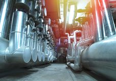 Equipment, cables and piping. As found ine of  industrial power plant Stock Images