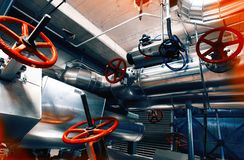 Equipment, cables and piping at factory royalty free stock images