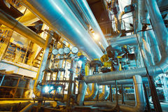 Equipment, cables and piping inside of a modern industr Stock Images