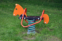 Equipment in a children's play park grass Royalty Free Stock Image