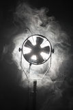 Equipment of cinematography. Switched cinema spotlight standing in the dark enveloped in smoke royalty free stock photo