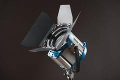 Equipment of cinematography. Turned on cinema spotlight isolated on black background royalty free stock photos