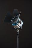 Equipment of cinematography. Turned on cinema spotlight isolated on black background royalty free stock photo