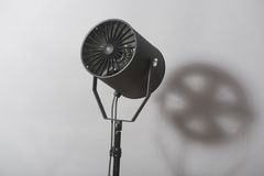 Equipment of cinematography. Turned on spotlight standing with the shade. Isolated on white background stock images