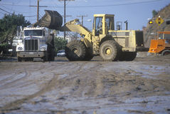 Equipment cleaning up after the mudslides Stock Photos