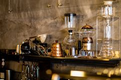 Equipment for coffee and drinks. Coffee equipment and drinks placed on the shelves, including a glass jar, kettle, available at the store stock images