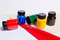 Equipment for cold batik: artist paints and glass tube. Stock Image