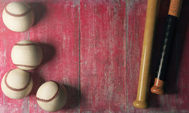 Equipment concept. Top view of baseballs and bats on aged red wood surface with copy space. Equipment concept. 3D Rendering Stock Images